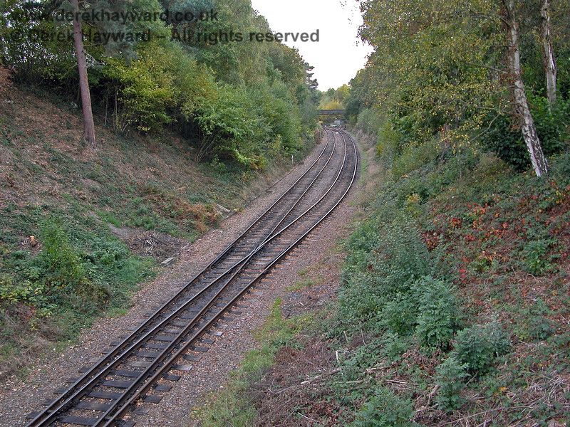Five years later, this is the reverse of the previous view, looking west from Groombridge.  The tracks were still being used as a run round loop and a start had been made on clearing the sides of the embankment nearest to the station.  19.10.2003