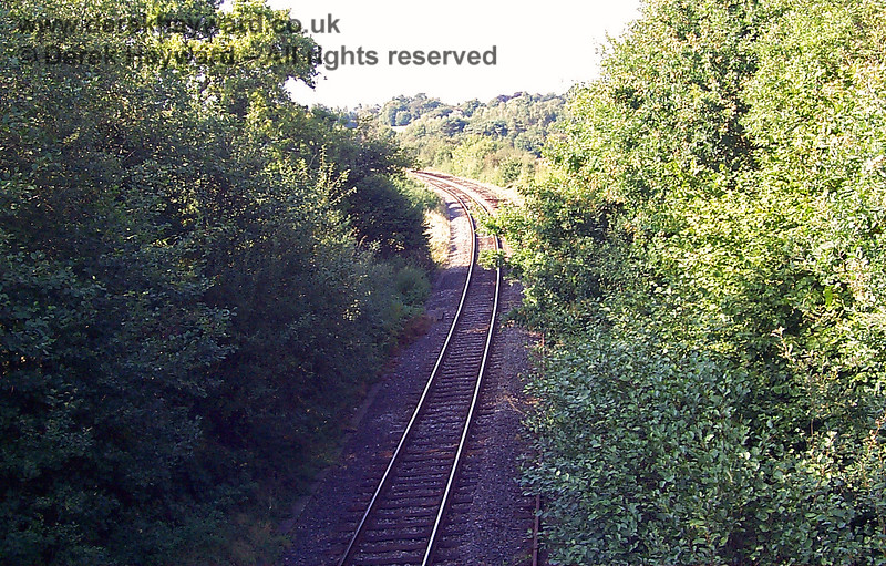 In an earlier low resolution image from 1998 the camera looks north towards Ashurst Junction as the operational Network Rail line passes under an overbridge at Corseley Road.  Although the railway had been converted to single line working (on the former Up line) large sections of the Down line remained in situ, with just a few random sections removed to no obvious pattern.  19.09.1998