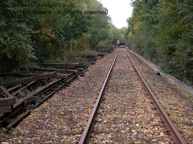 Looking north from just beyond the pile of sleepers in 2003.  At the time both lines were disused, and the up line was covered in debris. 19.10.2003