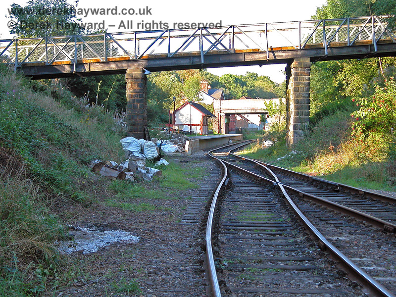 Looking towards Groombridge station from the run round loop, with work to extend the Spa Valley platform in progress.  Before the line closed the original Groombridge station was beyond the second bridge and a double track formation ran through both bridges. The alignment of the track in the foreground, installed during preservation, was later changed.  19.09.2005