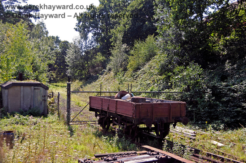 """The sidings on the Ashurst Spur were laid by the Spa Valley Railway in the late 1990s to store stock.  At the time the land was owned by a supporter of the railway who was content to allow the presence of the sidings on his land.  Following a change of ownership the new owner asked the railway to return the land and the sidings were permanently closed and lifted. Spa Valley ran a """"last train"""" on the line on 2 August 2018 using their DMU 1317.   The locked gates and remains of the spur are seen here after closure on 25.08.2019 20103"""