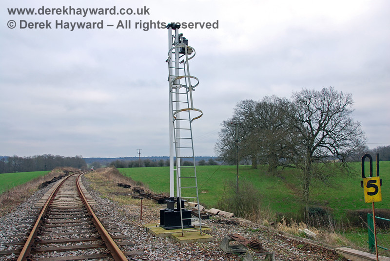 Looking east past the westbound Home Signal east of Groombridge Station. Note the modern safety cage on the ladder. 28.01.2008