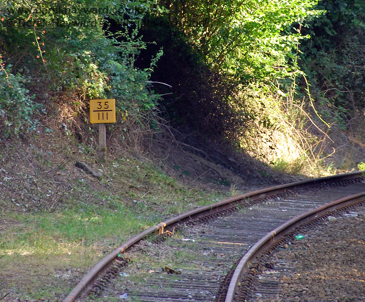 The removal of the bushes had exposed the milepost south of the station. 14.09.2008