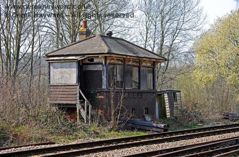 Eridge signal box, in a sad condition, with new sleepers outside awaiting installation.  27.03.2011 10432