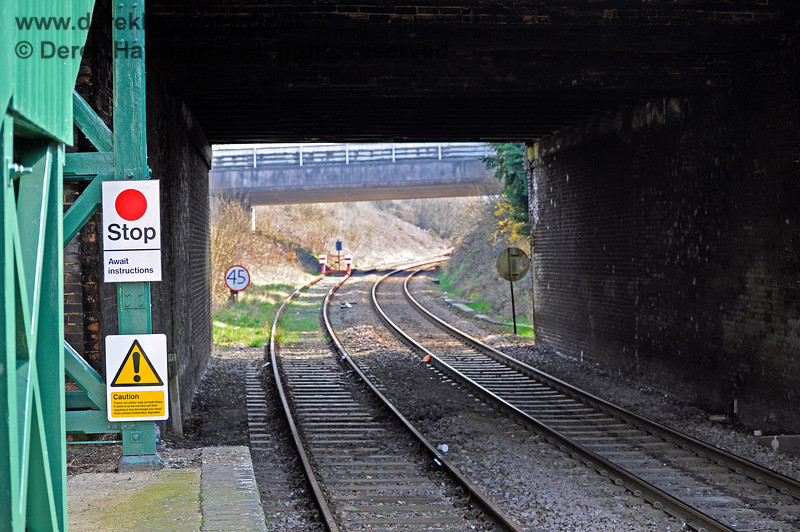 Looking under the southern bridge at Eridge.  The concrete bridge in the distance carries the main A26 over the railway lines. 27.03.2011 10436
