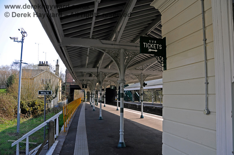 The refurbished Platforms 2 and 3 at Eridge, looking south. Note the steps to the Network Rail car park on the left and the traditional sign directing visitors to the Spa Valley Railway ticket office.  27.03.2011 6595