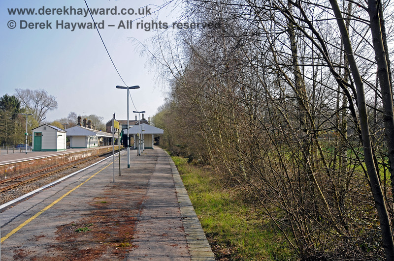 """Looking south from the northern end of Platform 1 at Eridge.  The """"proper"""" Platform 1 is on the right, but sadly now disused.  The trees are growing on a siding that stood adjacent to the platform road. 27.03.2011 6611"""