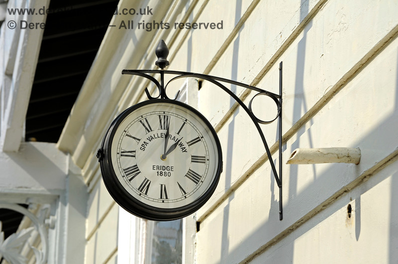 The traditional clock at Eridge. The date on the clock refers to the opening of the current station, but a smaller station was actually established here in 1868, on what was then a single line between Groombridge and Uckfield.  The larger station became necessary in 1880 when a second single line was established between Hailsham and Groombridge.  Initially the two sides of the station were operated separately, rather like the current SVR and Network Rail platforms, but this subsequently changed when double track was laid on the line to Uckfield and Lewes. 27.03.2011 10446
