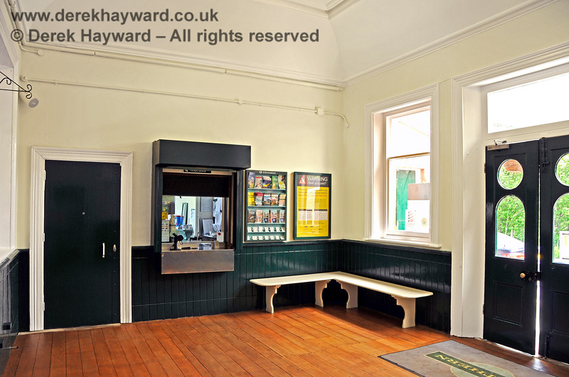 Inside the refurbished booking hall at Eridge Station, looking at the modern ticket window.  The modern booking office area was originally occupied by two rooms; a First Class Waiting Room and a Ladies Waiting Room with Ladies conveniences opening out of the back of the room.  The Victorian facilities are long gone.  29.05.2021 20598