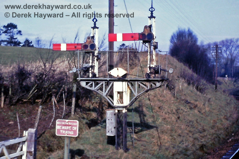 I am grateful to Eric Kemp for contributing historical images to this gallery.  The Eridge Up Home signals (south of the station).  The left hand (slightly lower) arm controlled the route into the former Platform 1, which has since been lifted.  23.02.1969.  Eric Kemp retains all rights to this image.