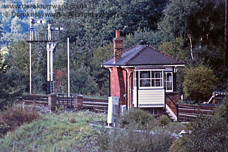 Eridge signal box, viewed from nearby fields, with the Down Home signals in the background. 21.09.1975.  Eric Kemp retains all rights to this image.