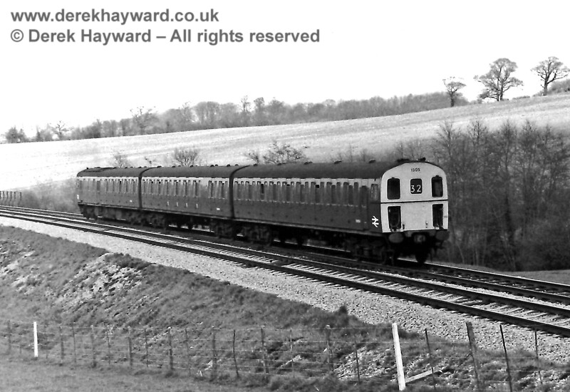 1305 near the site of Redgate Mill Junction (south of Eridge) with the 13:58 Tonbridge to Uckfield service. Sunday 20.04.1975.  Eric Kemp retains all rights to this image.