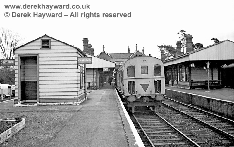 "On 30 January 1969, 1319 stands in what was then platform 3 at Eridge with a southbound train,.  The ""Gents"" is well signposted, and had an ""open door"" policy.   John Attfield retains all rights to this image."