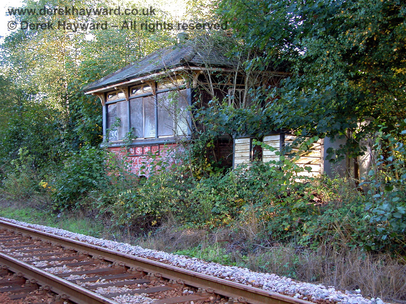 "A view of the signal box from the north showed that the signalman's ""convenience"" was also not in a good state of repair!   05.10.2003"