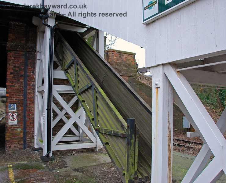 Under the footbridge to Platform 1 was a very rare disused mailbag chute. Sadly this was later demolished.  28.01.2008