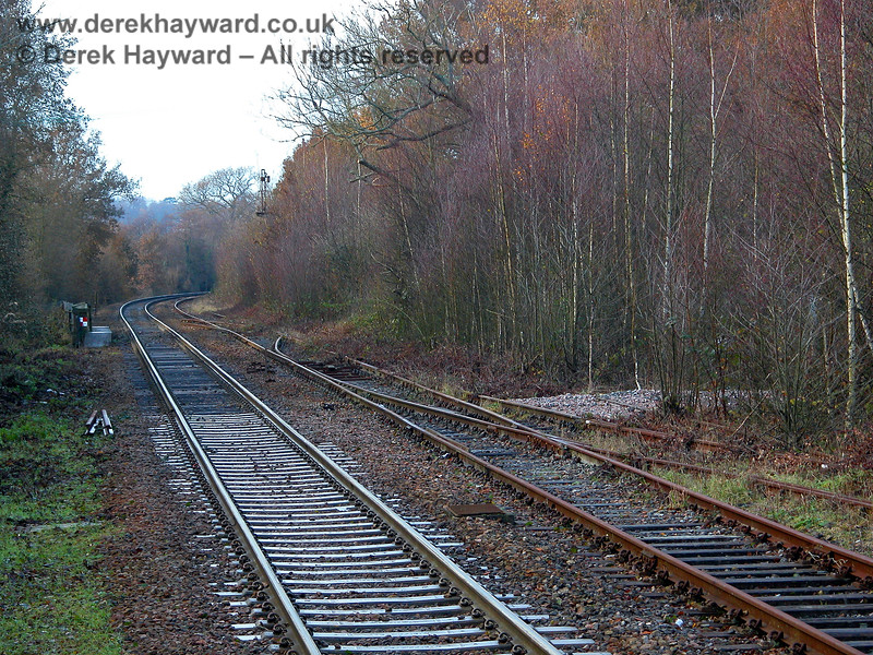 Taken with a long lens in 2005, this view north of the station shows the Spa Valley track on the right, together with their points to the disused goods yard and sidings.  A engineers access to the track can be seen by the points. 07.12.2005