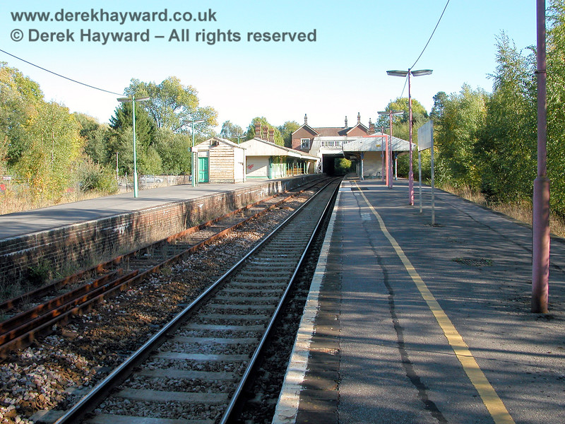 A 2003 view of Eridge looking south. The single Network Rail line is nearest to the camera.  The other island platform would later be used by the Spa Valley Railway.   The lamps at the north end of Platform 1 are still in the old red NSE colour scheme and looking very sad.  05.10.2003