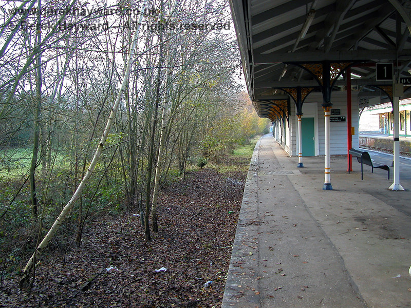 Looking north along platform 1 with the site of the former siding on the left. 07.12.2005