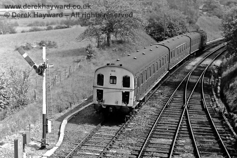 1313 passes the Eridge Down Starting signal as it leaves with the 14:58 service from Tonbridge to Uckfield. Sunday 01.06.1975.  Eric Kemp retains all rights to this image.
