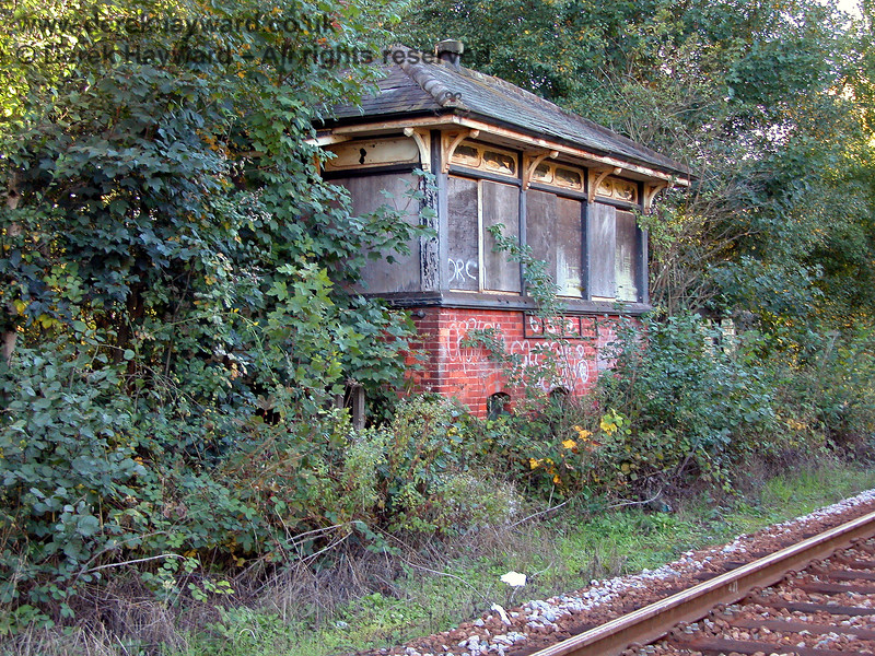 In 2003 the former signal box at Eridge had been almost completely swallowed by trees and bushes.  05.10.2003
