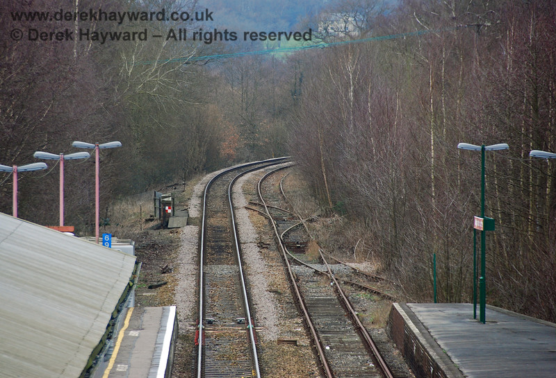 Lines run south into Eridge around a sweeping bend.  In this view north the Network Rail line is on the left and the (then) disused Spa Valley Railway line is on the right.  Note the points which provide access to the bay platform and access to a long siding (part of a former goods yard).  Furthest from the camera is part of an old crossover to the Network Rail line. 28.01.2008