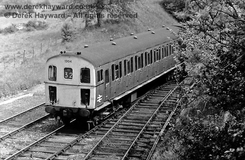 1304 arrives at the southern end of Eridge Station with the 15:08 Uckfield to Tonbridge train. Sunday 01.06.1975.  Eric Kemp retains all rights to this image.