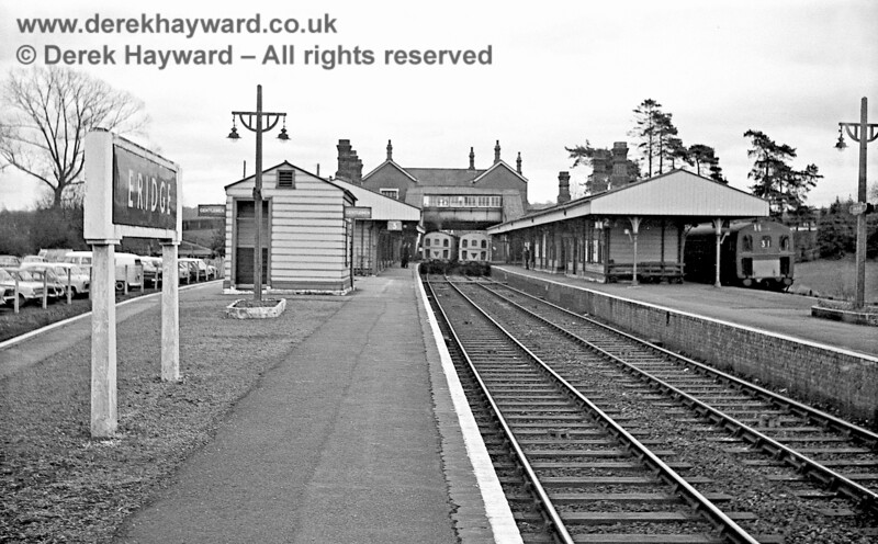 Looking south at Eridge on 30 January 1969. 1319 leaves with a southbound service as 1313 enters what was then Platform 2 with a northbound Oxted service.  Note the concrete support for the running in board and the concrete platform lights which cast a much inferior light to more modern lamps.  John Attfield retains all rights to this image.