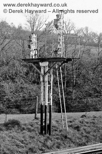 The remains of the Down Home signal at the closed Redgate Mill Junction south of Eridge. Sunday 20.04.1975.  Eric Kemp retains all rights to this image.