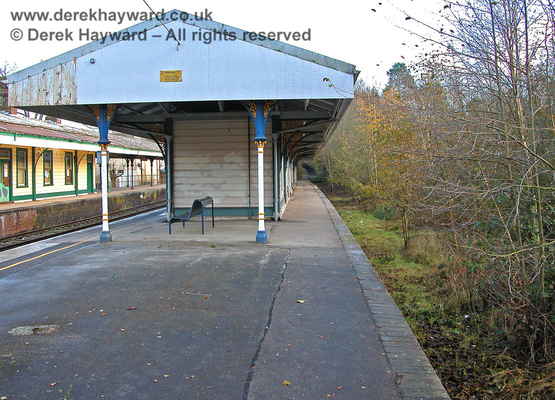 Further down the former  Platform 1 at Eridge, looking south.  Note the ornate colour scheme on the pillars. 07.12.2005