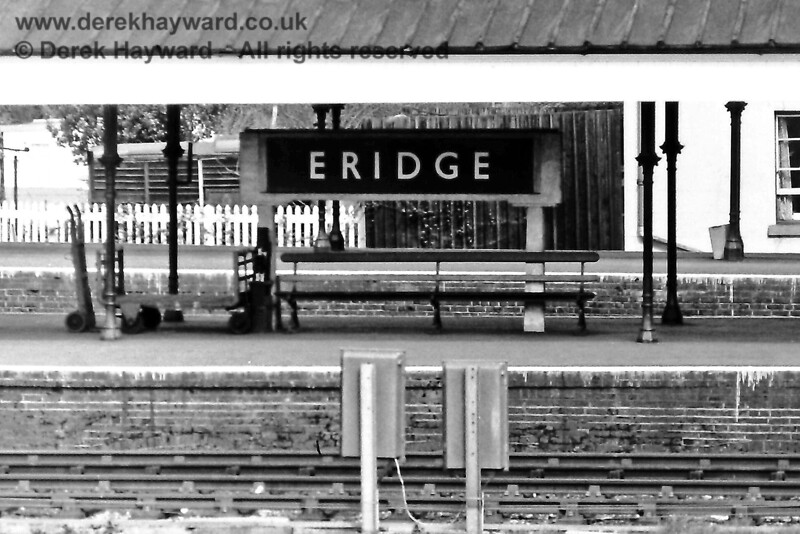 The running in board at the southern end of Eridge Station on 20.04.1975, encased in a less than attractive concrete support.  This board was on Platforms 1 and 2, as Platforms 3 and 4 were used for Down trains.  The board no longer exists, although the Spa Valley Railway have created one on the platforms that they use.  Eric Kemp retains all rights to this image.