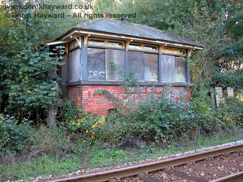 The former signalbox north of Eridge, slowly being swallowed by the bushes. 05.10.2003