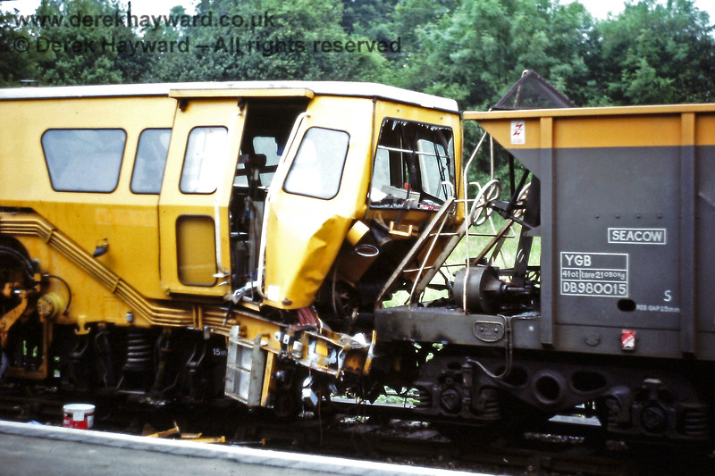 Eridge on Monday 02.07.1988.  A view of the damage to tamper DX73277 and SEACOW DB980015 after a collision during engineering works.  The SEACOW won the argument.  Eric Kemp retains all rights to this image.