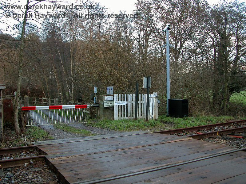 Forge Farm Crossing.  A photograph taken in 2005 shows the Network Rail cameras installed for safety reasons. 07.12.2005