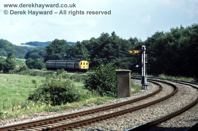 As things once were... 1125 approaches Forge Farm Crossing with the 15:35 Uckfield to Victoria service on Saturday 06.07.1985.  The Eridge Down Distant signal is in the foreground, with what appears to be a fog man's hut adjacent to the signal. In the very far distance, behind the unit, the northbound Eridge Advance Starting signal can just be seen, with Distant signals below it for the two routes at Birchden Junction.    Eric Kemp retains all rights to this image, and I am grateful for permission to use it here.