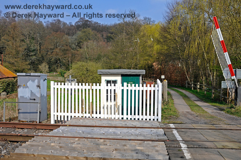 Looking east across Forge Farm Crossing towards the refurbished and fenced Crossing Keeper's hut.  Unusually the eastern gate is raised.  By default the gates should be kept closed at User Worked crossings and compliance at this location is normally good.  27.03.2011 6633