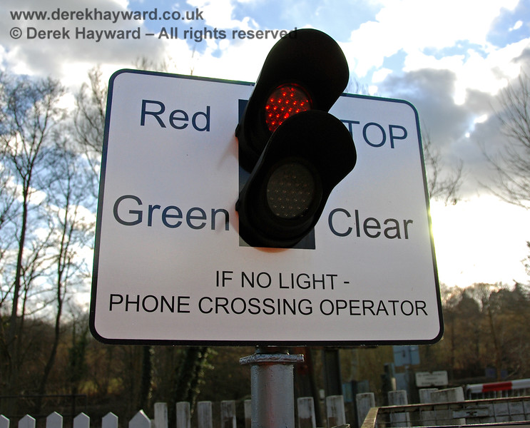 The red light at Forge Farm Crossing which only gives a very brief warning of the approach of a train. 02.03.2009