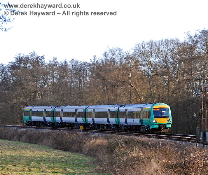 Turbostar 171806 runs north from Eridge with a London train. 02.03.2009
