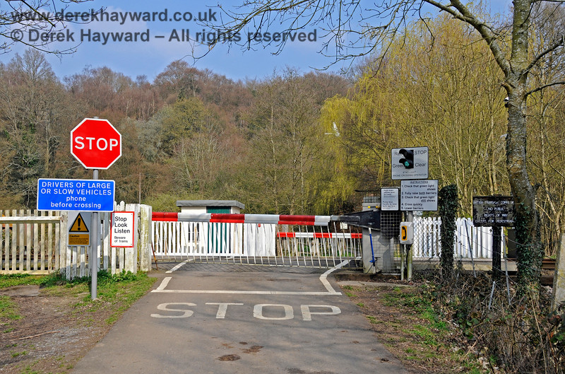 """By 2011 more modern """"Stop"""" and large vehicle advisory signs had been erected at Forge Farm Crossing.  This view looks east towards the farm.  27.03.2011 6628"""