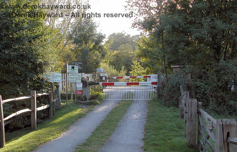 Looking back at the crossing from the private road on the east side in 2003.  If the Spa Valley Railway were to extend to Eridge the safety arrangements at this crossing had to work effectively for both companies on their respective lines. 05.10.2003
