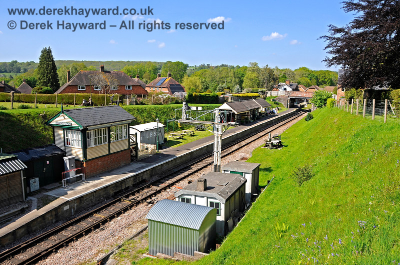 Looking east down the length of Groombridge Station platform, with a number of infrastructure buildings now concentrated around the signal box.  29.05.2021 20698