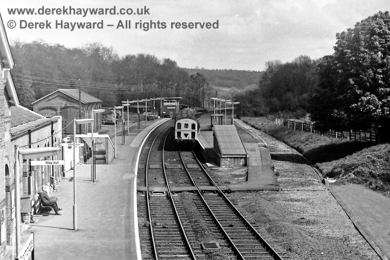 1302 stands at the main line side of what was once an island platform at Groombridge on Saturday 03.05.1975.  The train is the 11:58 from Tonbridge to Eridge .  Eric Kemp retains all rights to this image.