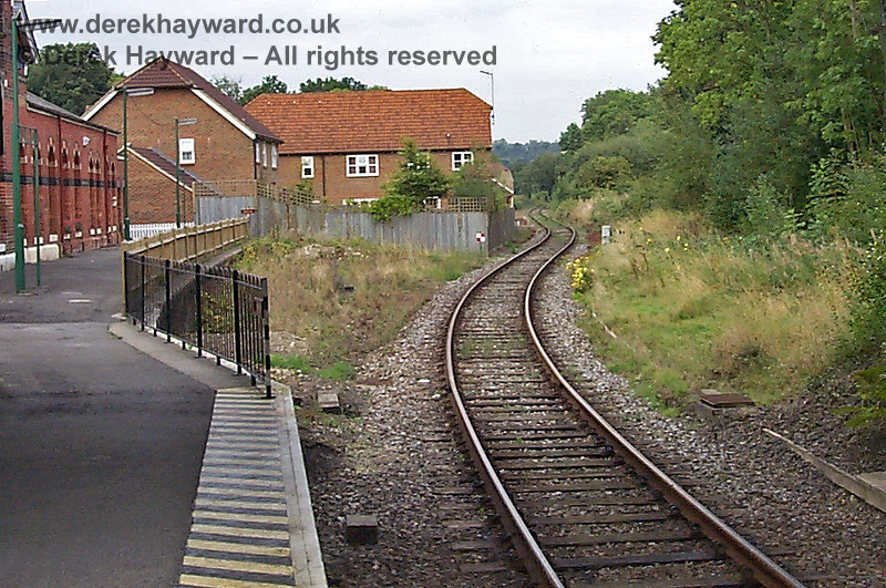 A low resolution image from 1998 showing the Spa Valley Railway track winding it's way behind the housing development and heading for it's new platform west of the old Groombridge station.  The approach was then very overgrown.  In allowing a very limited area of housing a historic railway building was lost.   17.09.1998