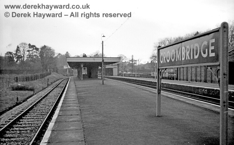 Groombridge Station looking west on 06 January 1966.  Virtually everything that can be seen in this image was demolished after closure, and the goods shed and goods yard on the right disappeared under new housing, as did the majority of the station. The track on the left very roughly follows the route of the current Spa Valley Railway, but there is no platform left in this area.  John Attfield retains all rights to this image.
