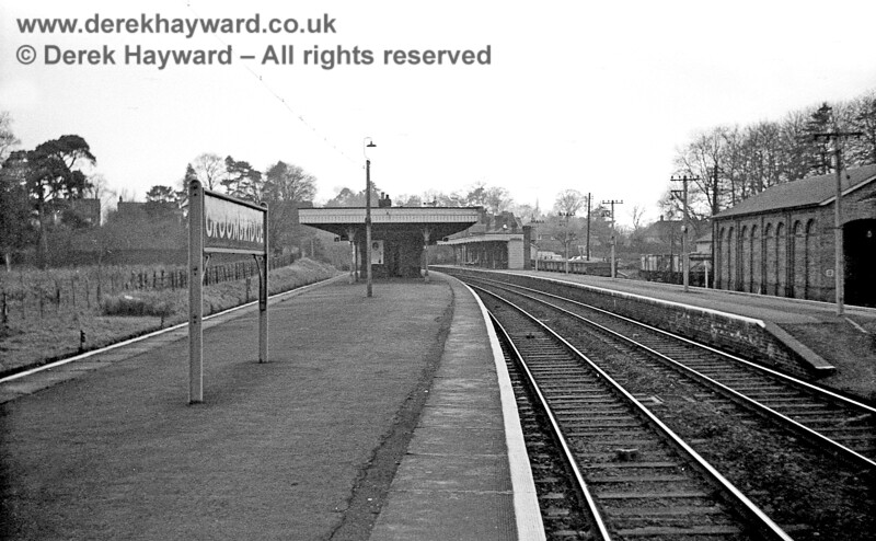 Groombridge Station looking west on 06 January 1966.  Virtually everything that can be seen in this image was demolished after closure, and the goods shed and goods yard on the right disappeared under new housing, as did the majority of the station. John Attfield retains all rights to this image.