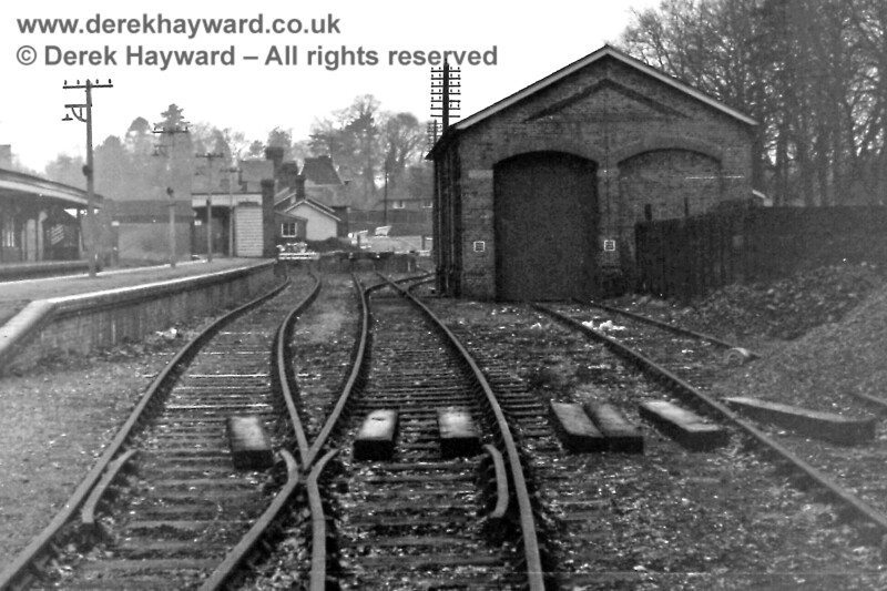 The (closed) Goods Yard at Groombridge, looking west, on 30.12.1969.  The cattle dock had it's own dedicated set of points so that access could be gained either from the middle siding or through the goods shed.  This also enabled an engine to haul wagons into the shed and then be released from the western end.   Eric Kemp retains all rights to this image.