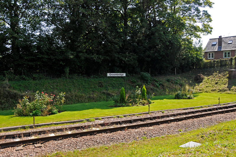 """By 2019 an attractive floral display had been formed opposite the old station building, and new """"Groombridge"""" station name boards had been erected. 25.08.2019 20058"""