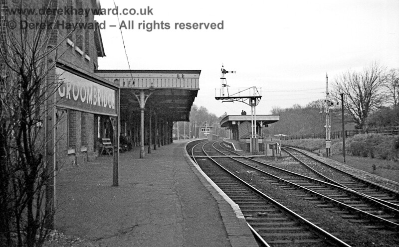 I am grateful to John Attfield for allowing me to use some of his historical images in this gallery.  Groombridge Station photographed on 06 January 1966. After closure in 1985 effectively every part of the station including and beyond the canopy was demolished.  The rear of the station building in shot survived as a walkway to the new Spa Valley station which was later sited behind the camera and the only track that survived was one roughly on the route of the line on the right.  Note the relatively modern signal box in the distance which had replaced an older building.  John Attfield retains all rights to this image.