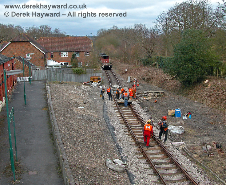 In 2006 the Spa Valley Railway PWay gang made extensive improvements to the trackbed in this area.  The bushes were also cleared. 19.03.2006