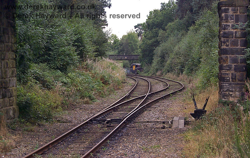 A closer view of the run round loop in 1998, with the ground frame controlling the points in the foreground.  In the distance, with the consent of the (then) landowner the railway had laid two short sidings on the area that had been formerly occupied by the Ashurst Spur.  A coach can be seen behind the gates.  A separate gallery covers this area.  17.09.1998
