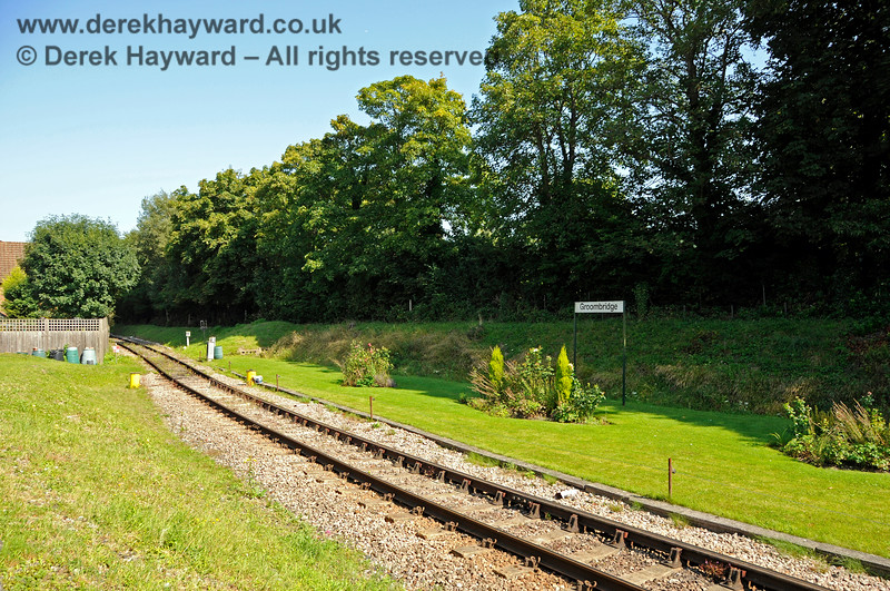 """By 2019 an attractive floral display had been formed opposite the old station building, and new """"Groombridge"""" station name boards had been erected.   So much better than the undergrowth previously covering the area.  25.08.2019 20068"""